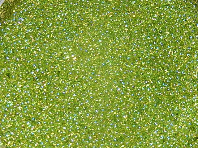 T1612 Miyuki rocailles 11/0 10 gr transparent AB chartreuse 258