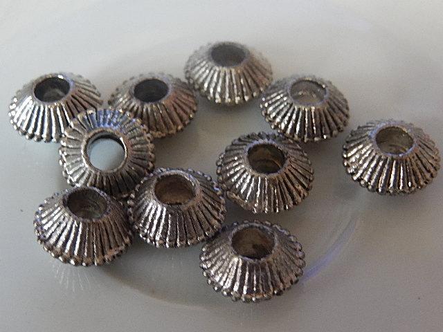 M0227 Tibetaans zilveren kraal 1 st bicone 7x12 mm