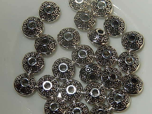 M0101 Tibetaans zilveren tussenkraal 1 st bicone 4x7 mm